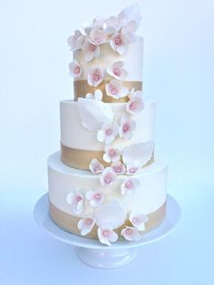 3 tier gold trimmed wedding cake with sugar flowers