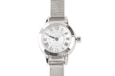 small dial silver Milanese strap metal watch with roman numerals.