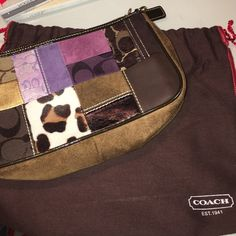COACH purse - offers welcome COACH small bag with multi fabric pattern on the front. Comes with dust bag pictured. Also has strap that you can use or unclip on one side and tuck in. Excellent condition, barely used. D-ring has some wear. Coach Bags