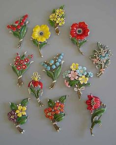 A garden's worth of lovely vintage Trifari enameled floral clips. #vintage #jewelry
