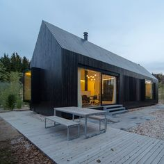 Blackened timber cottages added to a rural German resort.