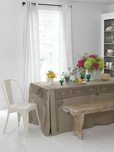 "Easy Makeover Ideas for Dining Rooms - Country Living - great idea for entertaining too (Cover, $68; 30""W x 6'L; Under Stella's Umbrella for stores. Table, $75; walmart.com.)"