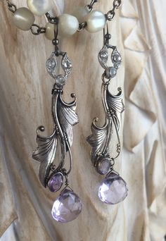 I hung beautiful sterling silver Art Nouveau leaf findings accented with faceted oval amethysts from vintage Art Deco rhinestone links, then added gorgeous faceted amehtyst briolettes below. These beauties are lightweight and so elegant! Approximately 2-3/4 inches from the top of their silver plated French ear wires and absolutely one of a kind.  Please also visit me at:  Jewelry supplies - www.thepariscarousel.etsy.com Newsletter - http://eepurl.com/UD0if Instagram - www....