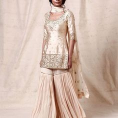 The Stylish And Elegant Gharara In Cream,Gold Colour Looks Stunning And Gorgeous With Trendy And Fashionable Raw Silk Fabric Looks Extremely Attractive And Can Add Charm To Any Occasion. Source by shiprashete ideas pakistani Bollywood Dress, Pakistani Dresses, Bollywood Fashion, Indian Dresses, Indian Outfits, Bollywood Style, Indian Bollywood, Pakistani Gharara, Pakistani Bridal Couture
