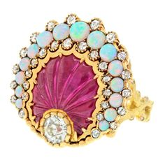 Carved Ruby Diamond Opal Sea Shell Ring | From a unique collection of vintage cocktail rings at http://www.1stdibs.com/jewelry/rings/cocktail-rings/