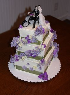 Wedding Cake with our Motorcycle Topper (http://www.weddingfavorsunlimited.com/motorcycle_riding_wedding_couple_cake_topper.html)