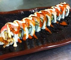 Apollo roll (soft shell crab, spicy tuna, cream cheese, cucumber, topped with red snapper, spicy mayo, hot sauce and eel sauce)