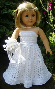 Ravelry:  American Girl Doll - Top Down Wedding Dress by Jacqueline Gibb (Beautiful, Lacy Strapless Dress whic is strapless with a detachable train at the back & comes with a little Bolero for wintery weddings.  The dress is a pull on design making dressing dolly easy.)