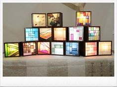 """Beautiful display of small pojagi in shadowboxes with backlighting! """"At Yongin City Hall Cultural Academy of Arts exhibition"""" - (Broken link that came from a Korean blog.)"""