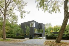 RAU architects have recently completed Villa S, a house in The Hague (Netherlands), that's covered Shou Sugi Ban (blackened wood) to create a cohesive look for the house.