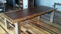 This 9' oak and walnut table finally made it to its new home in Maryville, MO.  It was a challenge but turned out to be beautiful and as sturdy as a tank.  The legs are hand hewn (ax cut) 6x6 from a barn built in the 1800's.  Looks great on top of the mixed variety of hardwood in the floor.