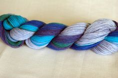 superwash sock weight yarn by ChromoKinetic... Such pretty colors!!! Want!