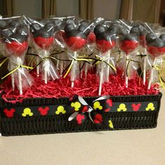 Mickey Mouse cake pops! :) The holder...basket is just as cute!!!