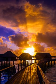 ~~Overwater bungalows at Sunset, Four Seasons Resort Bora Bora, French Polynesia by Blaine Harrington~~