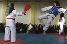 Women train in a tae kwon do club in Herat province, Afghanistan.