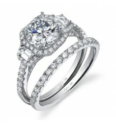 Style SY172  1-Carat Diamond Engagement Ring    This magnificent 18K white gold three-stone engagement ring features a 1-carat round brilliant center diamond. Accompanying the center are four baguette side diamonds and round diamonds enhancing the center for a total weight of 0.6 carats.
