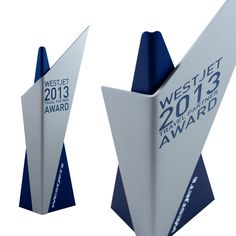 Our modern award design for WestJet Canada. The unique design reflects the clients branding and aeroplane aesthetic. Client - e=mc2 Calgary.