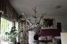 So, the branches are all put together. Now you need to put paper mache on them.. on the whole tree has three coats of paper mache. this is how it should look like.. like i said before use your imagination and design the tree the way you want.