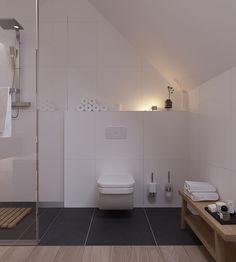 Disegno piastrelle nere che continua anche sotto il water e si abbinano con il pavimento in legno.