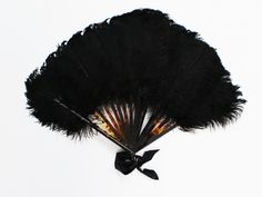 Showgirl Feather Fan - Vintage Art Deco Era Fan ★ Era: circa 1940s ★ Label/Designer: unknown ★ Measurements: 13 inches top to bottom, 18 inches end to end when extended ★ Materials: ostrich feathers ★