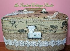 """The Scented Cottage - love this Train Case re-do!  """"Finally started on a train case.  Used some left over burlap, tissue paper with a French theme, vintage jewels and bits of old lace and trim.""""  Go visit this blog."""