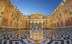 Palace of Versaille. I want to crawl into this picture and DANCE on those tiles!