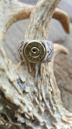 I love to hunt, shoot guns and make jewelry! This unique ring puts all 3 of those together in one hand carved, beautiful and super cool item. Antlers are naturally shed from Illinois Whitetail Deer. Bullet casings are safe. Any questions, please ask Deer Antler Jewelry, Deer Antler Crafts, Deer Antler Ring, Deer Horns, Antler Art, Bullet Casing Crafts, Bullet Crafts, Bone Crafts, Bone Carving