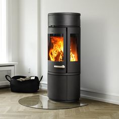 MORSØ 7943  The cylindrical wood burner is a real focal point. Whatever combination you choose, every incarnation features a panoramic view of your living flames, with a large curved front window and double-glazed glass to the sides.