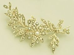 A fine and impressive Victorian, seed pearl and 15 carat yellow gold flower spray brooch; part of the antique jewellery / estate jewelry collections at AC Silver  http://www.acsilver.co.uk/shop/pc/Pearl-and-15-ct-Yellow-Gold-Flower-Spray-Brooch-Antique-Victorian-35p4387.htm