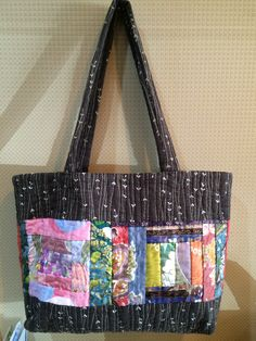 totebag. Flourish color patch work shines on the black base.