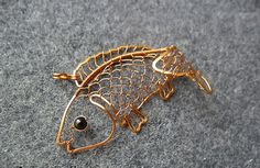 Koi-fish Copper necklace - makeMeStyle on Etsy has done some impressive wire work here.  Love it.