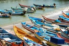 Boats lined up on the shore at the southern tip of India.