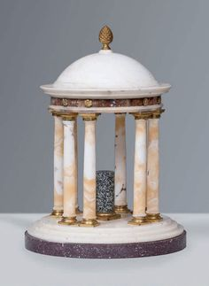 Tempietto, Rome 18th/19th Century. This round temple centerpiece by Luigi Valadier or his followers is typical of the production made in Rome during that period. Eight paired columns in alabastro cotognino have Doric bases and capitals in gilded bronze; the architrave, in portasanta marble, has small rosettes immediatly above the columns; above, a moulded cornice supports the white marble dome with a bronze pine cone on top. At the centre is a granite column shaft - Dim: H: 35 cm; Diam: 25…