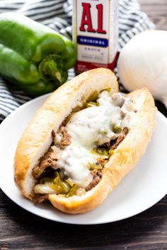Slow Cooker Philly Cheese Steak Sandwiches get a punch of flavor with A.1. Sauce in this hearty, comfort food recipe. This is an easy slow cooker recipe that the whole family will love! #ad
