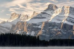 """""""All That's Gold""""  The spectacular north side of Mt. Rundle as seen from Two Jack Lake in Banff just after sunrise. One of the coolest sunrises I've seen in a while!  I've just finished a blog post with my set of images from my trip to Banff and Jasper. Check out the link in my profile to see the full set! Prints are available for most images - contact me to learn more!  #banff #banffnationalpark #alberta #travelalberta #parkscanada #ohcanada #canada #imagesofcanada #wildlycreative #mybanff…"""