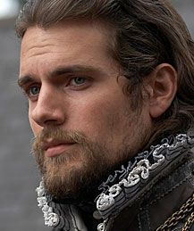 Ahhhhh... Henry Cavill.     Love him with a beard. Very distinguished.