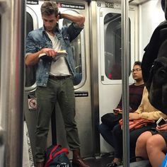 This ruggedly handsome guy looks like a long lost Hemsworth brother and I am NOT mad about it. His blatant disregard for those subway safety signs has me thinking he isn't afraid to break the rules. Guys Read, Chica Cool, U Bahn, Attractive Men, Hemsworth, Book Nerd, Hot Boys, Handsome Boys, Pretty Boys