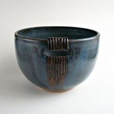 I threw this original bowl on the potter's wheel, trimmed it and added texture to the rim. Later I cut an opening and added coils and lines. I