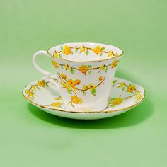 Royal Albert Crown China 1950's England Handpainted Yellow Flowers Teacup and Saucer by StarfishCollectibles on Etsy https://www.etsy.com/listing/194112788/royal-albert-crown-china-1950s-england