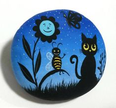 Hand painted stone with a silhouette of a bee, butterfly, sunflower, and Cat! A great Gift Idea for your friends! Is painted on a smooth sea stone which i have collect from a beach on a Greek island. Is painted with fine art quality acrylic colors and very small brushes for the detail,