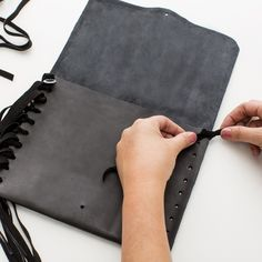 This gorgeous leather DIY fringe clutch is the ultimate accessory! Take our accompanying online class <https://www.brit.co/shop/catalog/design-a-handbag-with-rebecca-minkoff-online-class_40708/>Handbag Design with Rebecca Minkoff Online Class</a> to take your handbag game to the next level. This kit provides everything you will need to craft a beautiful suede and leather Rebecca Minkoff clutch that's bound to become your new go-to purse. This clutch features a metal pin closure, a Rebecca…