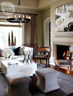 A detailed limestone mantel and gothic arched doorway form the traditional backbone of the living room.