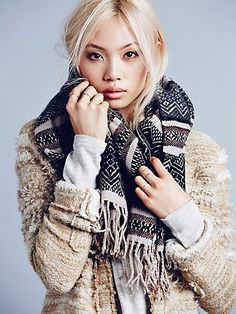 Keep warm in this super soft fairisle printed scarf with raw trim and fringe edges.