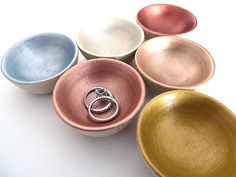 Store your jewelry or other tiny items in style in this painted wood bowl. Choose from Gold, Silver, Bronze, Platinum, Rose Gold or Warm Rose Gold.