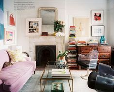 I love how eclectic this is - pink sofa is pretty delicious.  Books, dog, dresser.  A good mix.  mary nelson sinclair via lonny
