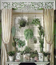 plant window screen, nicely filled in! I would have milkglass planters. My hemp neutral curtains on a rod would stay and my table would be a thrifted find in wood. Not as glamorous but I love the idea.