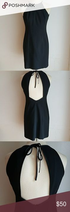 """LAUNDRY Black Sleeveless Backless Dress Excellent Condition ~ Worn Once ~ No Noted Tears, Flaws, Stains ~ Smoke Free and Clean.  Black with Satin Trim to Neckline and Ties ~ Ties Behind Neck ~ Lined ~ Hits Above Knee ~ 100% Polyester ~ Zips Up Back (tested) ~ Cut Out Back  Runs Small????  Mannequins Measurements Are: 32.5"""" x 25"""" x 33"""" All Measurements Are Approximate and Taken With Garment Lying Flat.  Length 33"""" Bust (armpit to armpit) 14.5"""" Waist (side to side) 14"""" Hips (side to side) 16""""…"""