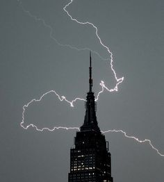 Lightning strikes near the Empire State Building in New York City. Photo by Timothy A. Clary/AFP/Getty Images.