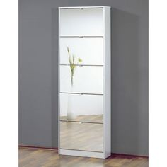 Tall Mirrored White Shoe Cabinet with Five Drawers | eBay Shoe cabinet in White, shoe storage with five mirror glass drawers Stunning mirror glass on compartment door fronts Enough space for all your shoe storage needs High quality furniture made in Germany Can Hold approx 10 pairs of shoes Add elegance to your space with this modern storage unit Contemporary furniture at the best price's Dimensions:  W58cm x D17cm x H169cm  £149.95