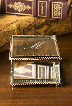 Showcase your jewelry or treasured trinkets in our gorgeous Monogrammed Glass Decorative Box.